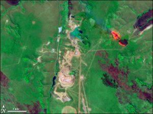 Satellietbeeld van de Catoca-mijn in Angola.  Bron: Wikimedia Commons