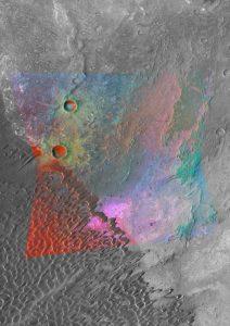 De ruimtesonde Mars Reconnaissance Orbiter werpt een nieuw licht op de diversiteit van de marsbodem. In deze krater tonen de magenta plekken veldspaat, een bestandsdeel van grafiet. Bron: NASA/JPL/JHUAPL/MSSS