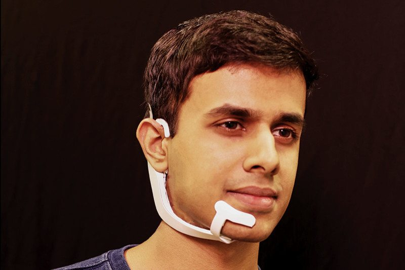 Arnav Kapur models the AlterEgo device he co-created Lorrie LeJeune, MIT