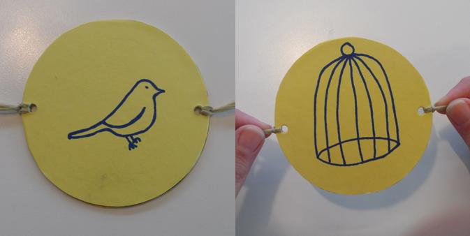 Teken aan de ene kant van het karton een vogel, en aan de andere kant een kooitje.