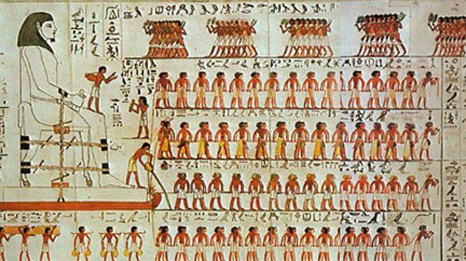 De wandtekening waar op te zien is dat de Egyptenaren de ondergrond voor de slee bevochtigen. Bron Al-Ahram Weekly